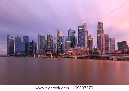 Skyline of Singapore's financial center in downtown area at sunset