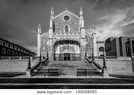 Madrid Spain - May 21 2014: View of the San Jeronimo el Real (St. Jerome Royal Church) before the storm. Roman Catholic church located in central Madrid Spain. Black and white photography.