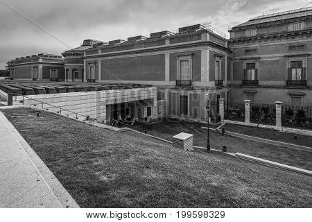 Madrid Spain - May 21 2014: People at the entrance to Museo del Prado Madrid Spain in rainy weather. Black and white photography.