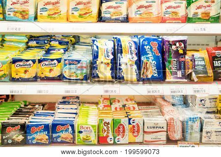 Bangkok, Thailand - August 13, 2017: Shelves of Cheese in a supermarket.