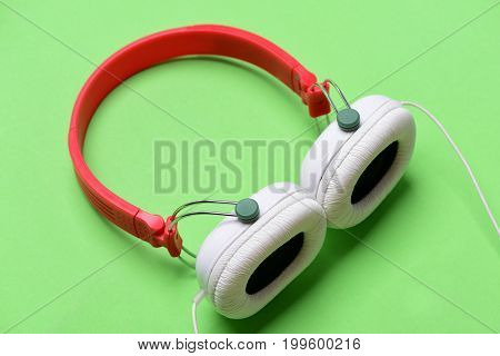 Modern And Stylish Earphones Isolated On Light Green Background