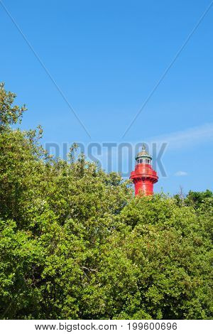 Top of cast iron lighthouse red and white at the French west beach