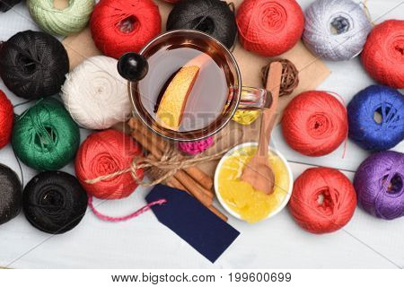 Mulled Wine And Yarn Balls Of Various Colours, Top View
