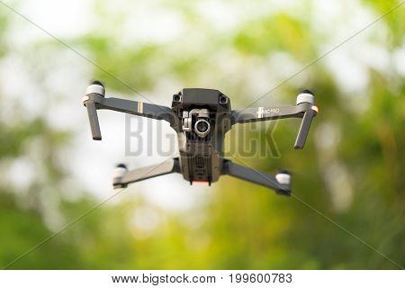 Moldova, Chisinau - August 11, 2017: Dji Mavic Pro Drone Flying For Video Shooting On The Green Park