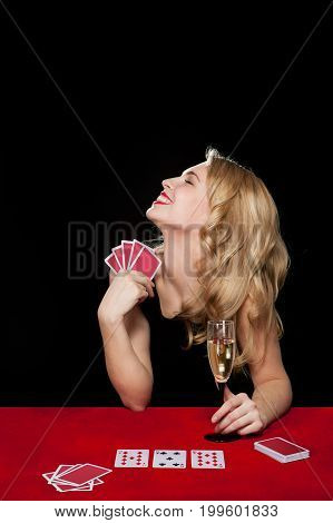 young girl playing in the gambling on black background