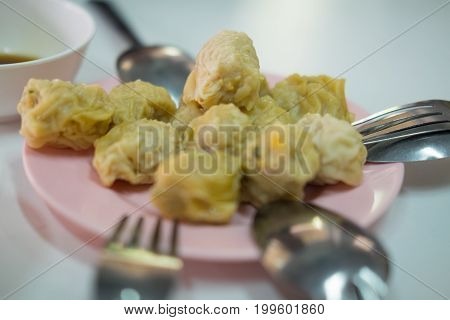Chinese steamed dumplings (Dim Sum) on pink dish