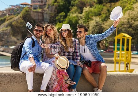 Group of friends taking funny portraits outdoor.