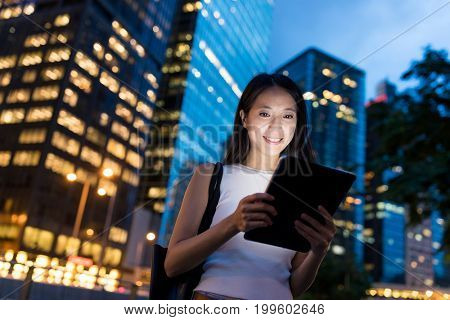 Woman use of digital tablet computer at night