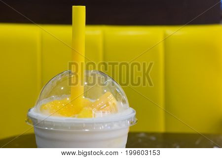 Yogurt pudding with slice of fresh mango