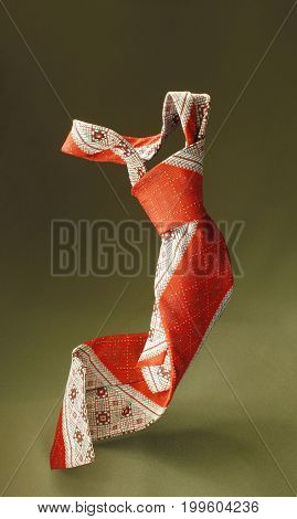 Red With White Necktie On Green Fabric Background, Fashion Accessory Close Up
