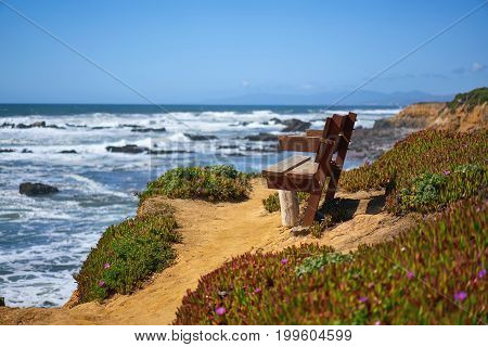 Path and bench on a bluff with view at the Pacific Ocean, Santa Cruz, California, USA