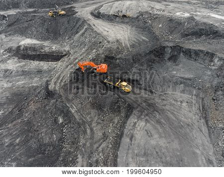 Aerial view open pit mine, loading of rock, mining coal, extractive industry anthracite