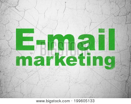 Marketing concept: Green E-mail Marketing on textured concrete wall background