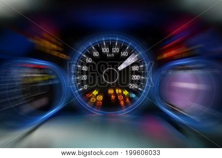 Motion blur of modern car instrument panel dashboard with blue illuminated display and show all led signs, rev up.
