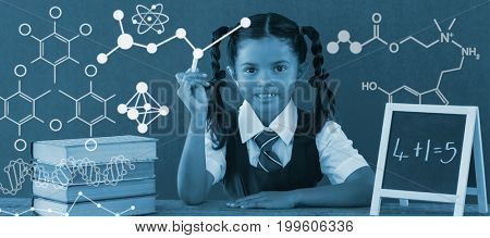 Illustration of chemical formulas against schoolgirl calculating sums at desk