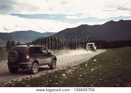 Off-road Jeep car on bad gravel road. Rally racing SUV off-road in the evening