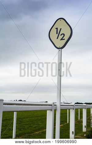 Half furlong marker at horse racing venue