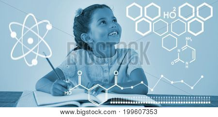 Digital image of atomic structure  against young girl writing in her book against white background