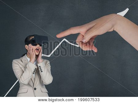 Digital composite of Hand pointing at surprised business woman in a VR headset against blue background with arrow