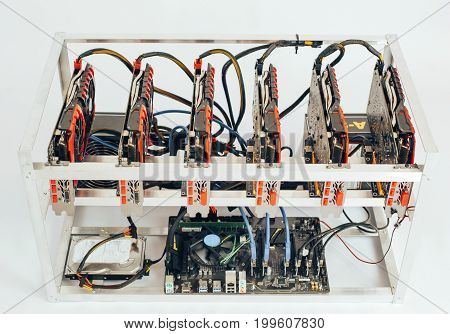 Mining of crypto-currencies. Farm from video cards on a white background