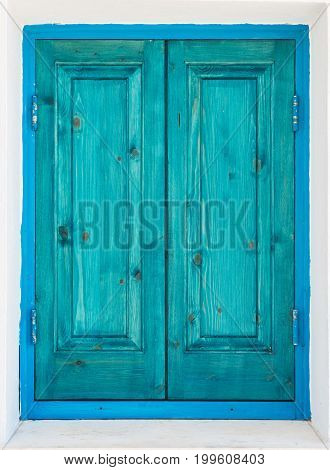 Green turquoise painted wooden window shutters. Architectural detail