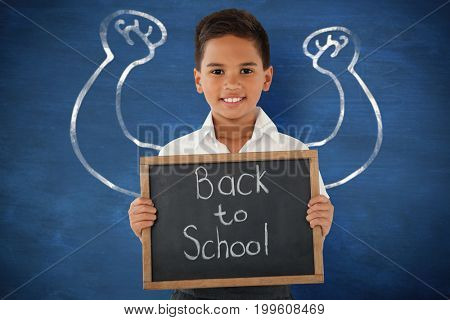 Schoolboy holding slate with text over white background against blue background