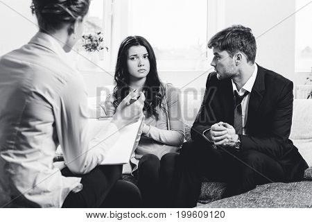 Young couple with a problem to consult a psychologist
