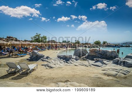 PAROS ISLAND, GREECE, JULY 3, 2017: People enjoying a perfect day at the famous beach of Kolimbithres located in Paros, Cyclades islands, Greece.
