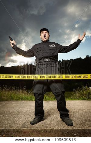 Police man guarding place of crime waiting for technician
