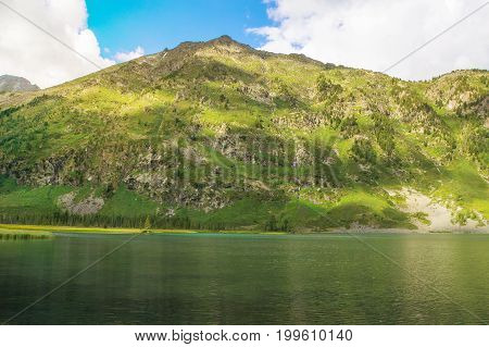Beautiful Mountain Landscape With One Small Mountain And A Lake