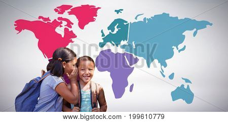 Girl with backpack whispering in friend ear against grey background