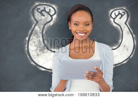 Hand flexing muscles over white background against front view of a black woman looking at camera