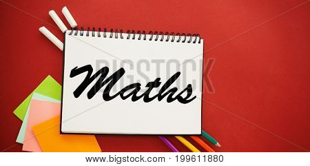 Maths text against white background against high angle view of spiral notebook and colorful pencils