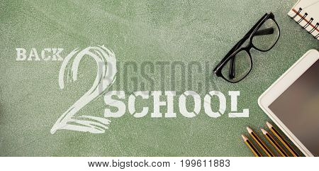 Back to school text on white background against high angle view of tablet and eyeglasses