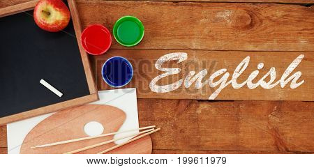 English text against white background against palette with chalkboard on table