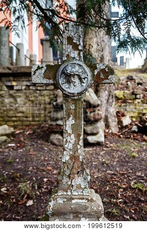 Old Christian cross made of concrete in the Rasos cemetery in Vilnius Lithuania