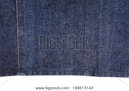 Piece of dark blue jeans fabric isolated on white background.