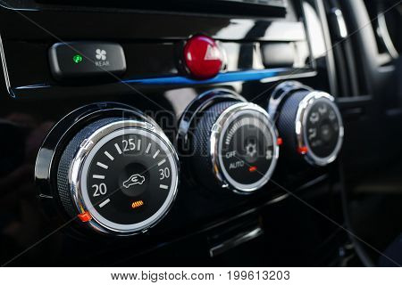 Close up car interior console details with air condition control