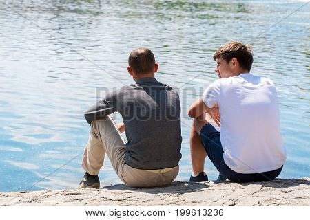 Two good friends communicate by the river