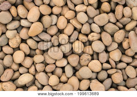 Orange Brown Rounded rocks stones Texture abstract background