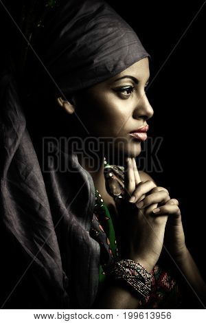 African black young woman beauty portrait with turban headscarf profile muted colors studio shot