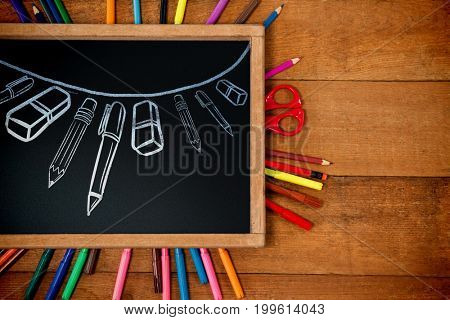 Graphic image of school supplies arranged against high angle view of chalkboard with multi colored equipment