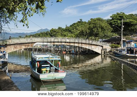 Paraty Brazil - February 24 2017: An iconic view of the canal and the colonial houses of the historic town Paraty Rio de Janeiro state Brazil