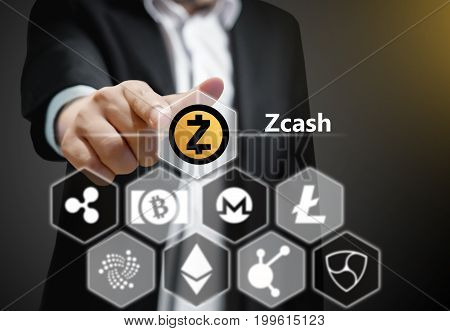 Business man points his finger at Zcash icon Concept of Cryptocurrency a digital currency