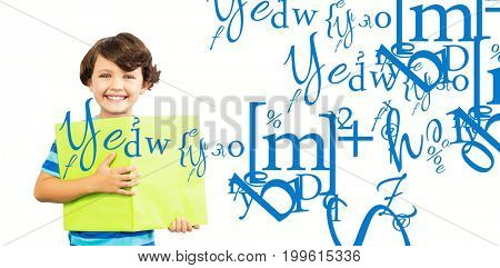 Portrait of smiling boy holding green book against letter and number jumble