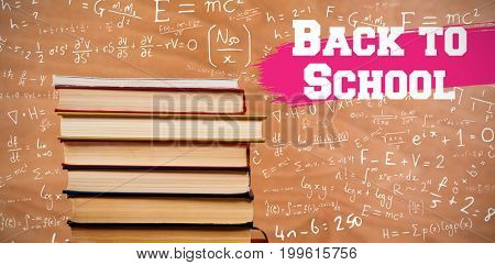 Back to school message against hardcover books stack
