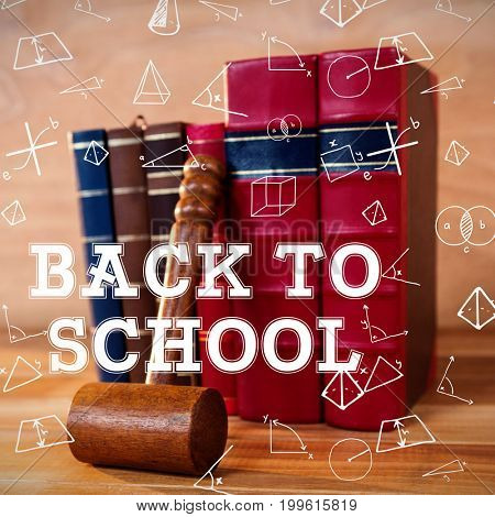 Back to school message against gavel with books