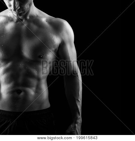 Close up view of very muscular handsome sexy guy isolated on black background naked torso