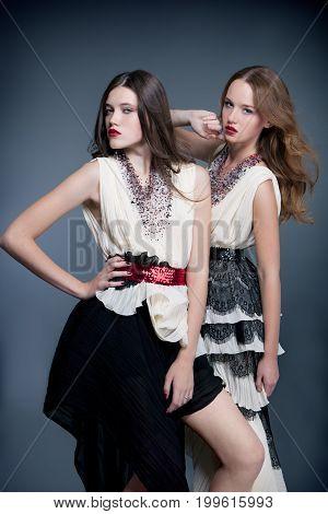 fashion models posing on gray background. Closeup.