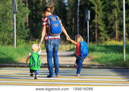 Mother with two kids going to school or daycare, back to school
